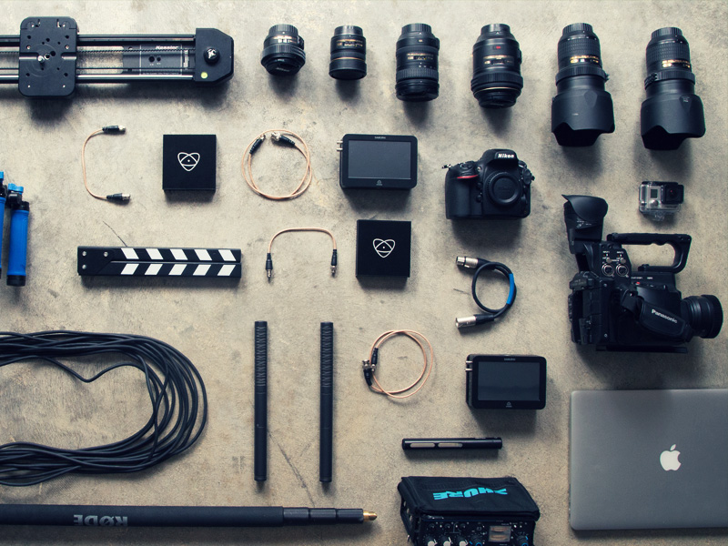 Flat lay of different photography equipment. Lenses, cameras, stands