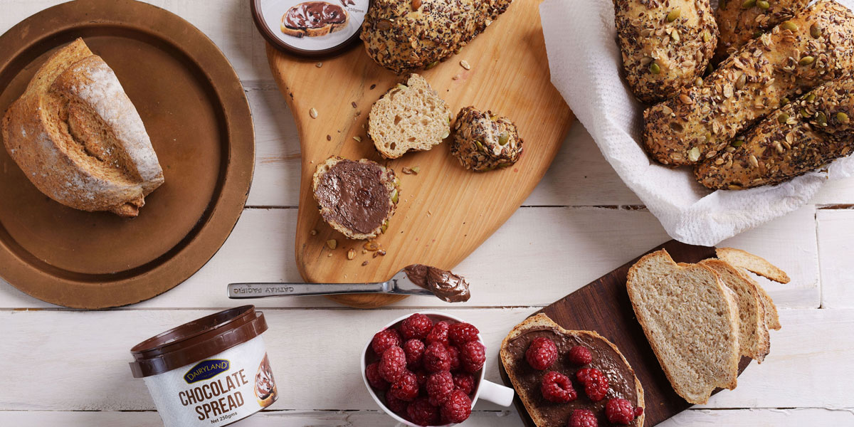 Dairyland chocolate spread with fresh bread on a table